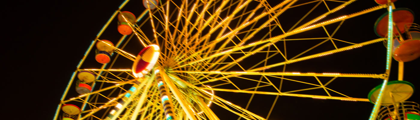 Photograph of a ferris wheel at night